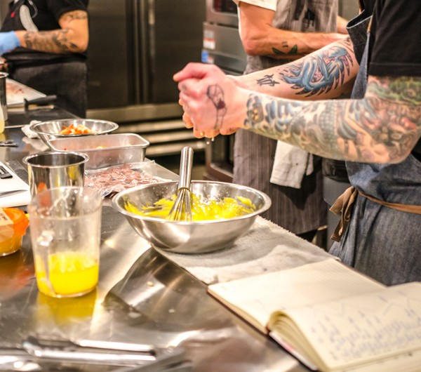 Photograph of Wheat and Sons doing food prep for The Overlook fine dining event.